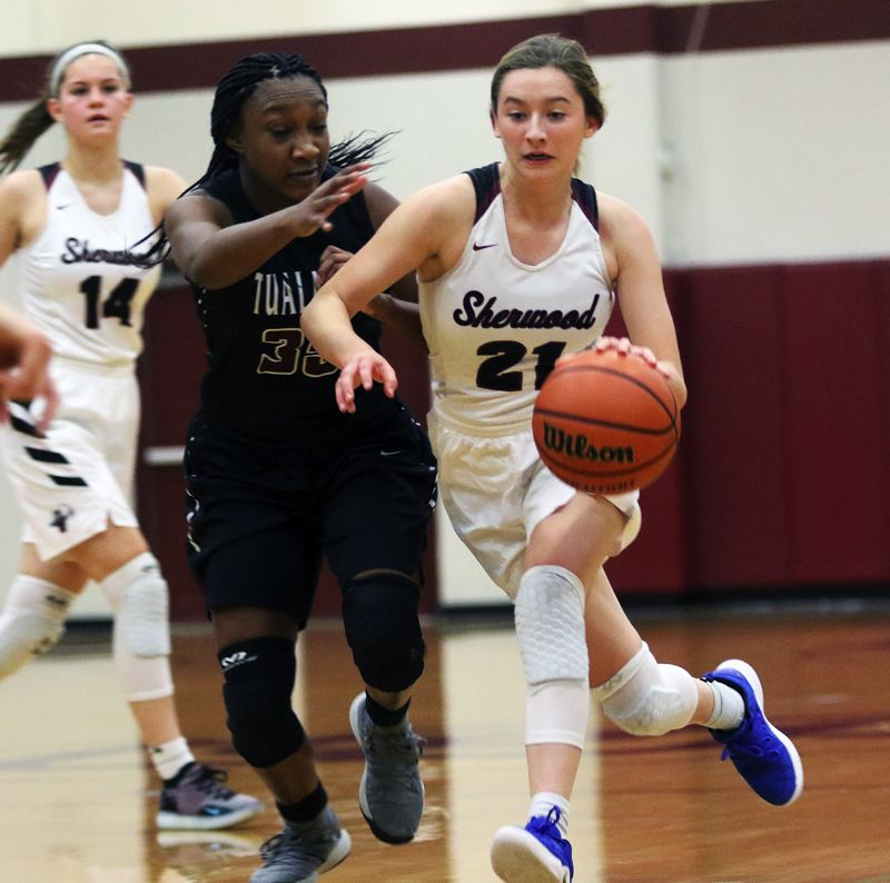 TIMES PHOTO: DAN BROOD - Sherwood junior Ava Boughey (right) tries to get past Tualatin senior Maliyah Ross during Tuesdays game.