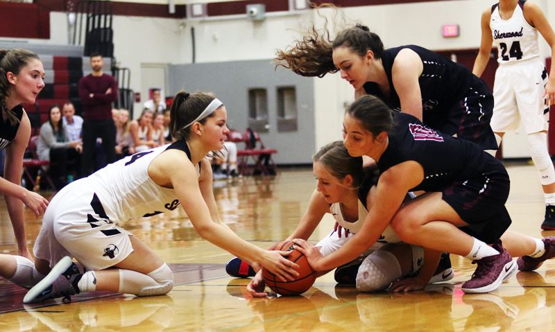 TIMES PHOTO: DAN BROOD - Sherwood's Alex Verkamp and Joley Sproul and Tualatin's Kasidy Javernick and Kassidy Lewis battle for a loose ball during Tuesday's game.