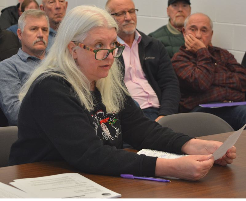 SPOTLIGHT PHOTO: COURTNEY VAUGHN - Jennifer Cuellar, shown here addressing the Columbia County Board of Commissioners about a supplemental budget on Dec. 5, is set to leave her position in Columbia County before the end of the year.