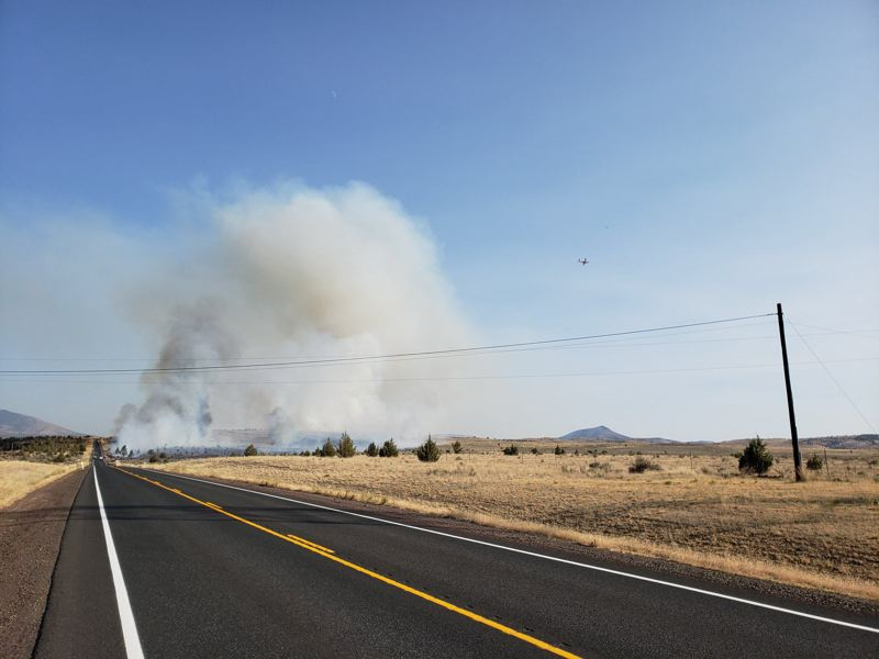 COURTESY PHOTO - Smoke from a Central Oregon grass fire illustrates the problem facing many people in rural Oregon.