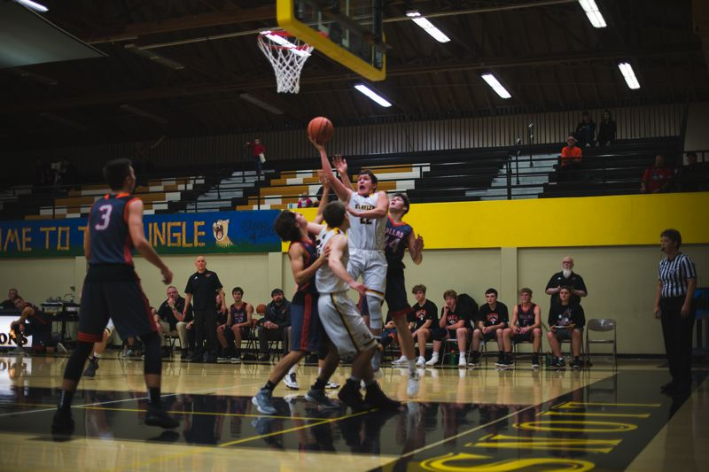 PHOTO COURTESY: JEREMY DUECK - St. Helens' Canon Beisley drives the baseline for a shot attempt during a Tuesday nonleague game at home against Dallas.