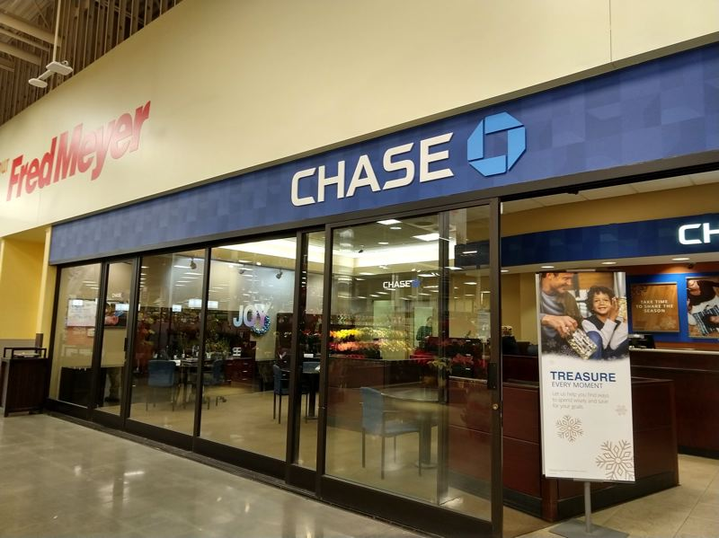 SPOTLIGHT PHOTO: COURTNEY VAUGHN - A Chase bank inside the Scappoose Fred Meyer grocery store was robbed Tuesday evening. Police say the suspect arrived in a motorcycle helmet and used a gun to demand cash.
