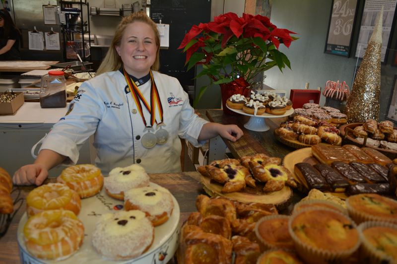 SPOTLIGHT PHOTO: COURTNEY VAUGHN - Megan Bamford overlooks an array of seasonal cupcakes, cookies, donuts and croissants at Bamford Bakery in Scappoose. Bamford recently won a silver medal after competing with Team USA in the Villeroy & Boch Culinary World Cup.