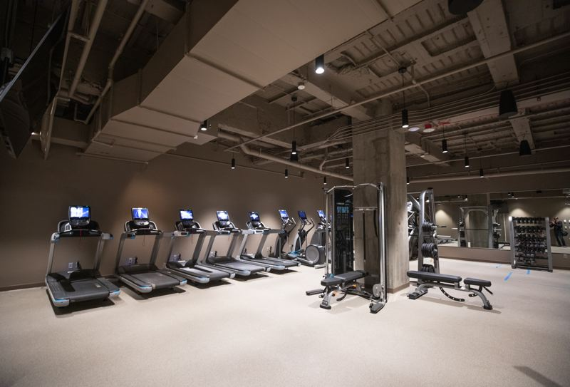 TRIBUNE PHOTO: JONATHAN HOUSE - OSU Portland Center employees have access to tenant amenities that include a basement gym outfitted with the latest workout equipment.