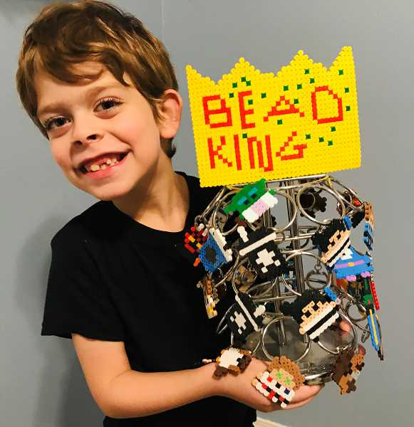 CONTRIBUTED PHOTO: ROB HENDRICKSON - Austin Hendrickson, 6, started his own business Bead King where he sells art pieces and keychains made with Perler-brand beads.