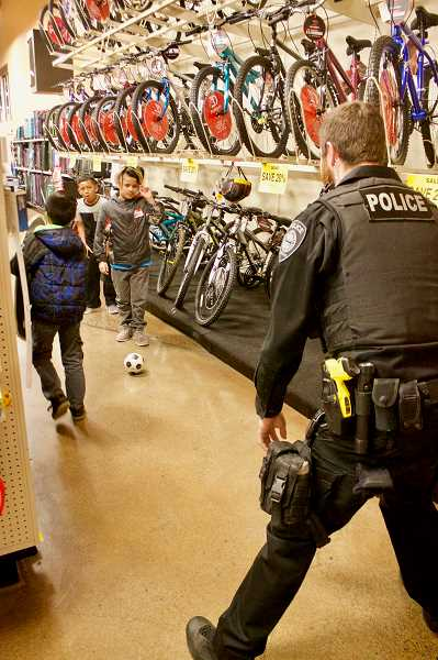 OUTLOOK PHOTO: CHRISTOPHER KEIZUR - During Shop with a Cop, impromptu games of catch and soccer break out in the aisles of the Burnside Road Fred Meyer store.