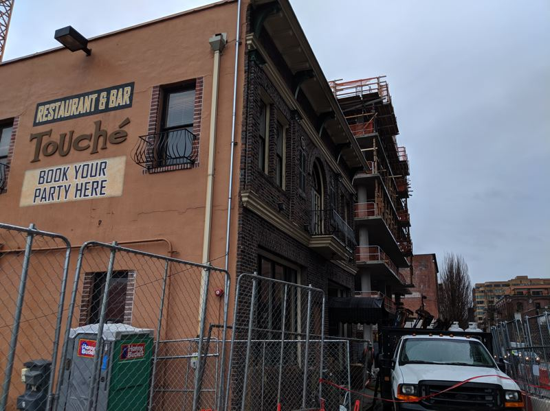 PAMPLIN MEDIA GROUP: JOSEPH GALLIVAN - After locals objected, the Touche bar in the old fire house has been preserved and the landowners built the new development at NW 14th and Glisan St around it.