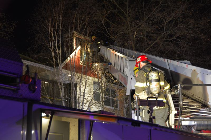 COURTESY PHOTO - Firefighters with the Hillsboro Fire Department check for hot spots at the Commons at Verandas Apartments, 2501 N.E. Overlook Dr., on Friday, Dec. 7,