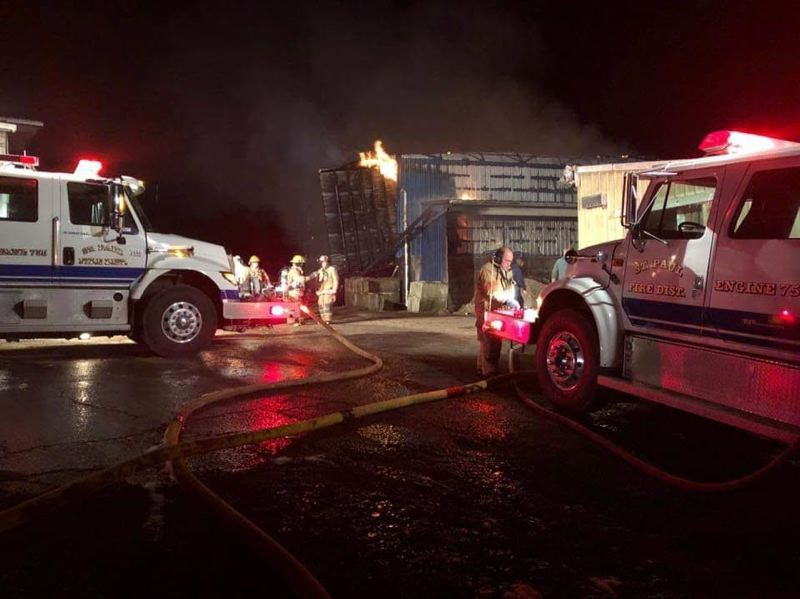 COURTESY PHOTO: ST. PAUL FIRE DISTRICT - Firefighters battle a fire at a St. Paul dairy on Champoeg Road on Dec. 7.