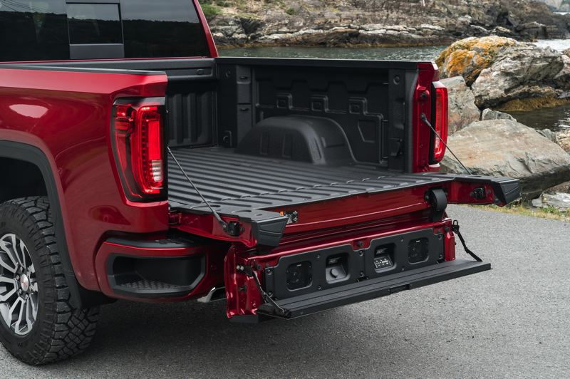COURTESY GMC - All Sierra pickup come with the GMC-only MultiPro tailgate that can be configured as a step and a work bench.
