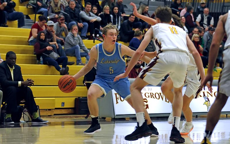 PAMPLIN MEDIA GROUP PHOTO: WADE EVANSON - Lakeridge senior guard Charlie Maynes looks for room to operate during his team's 65-51 loss at Forest Grove on Friday night.