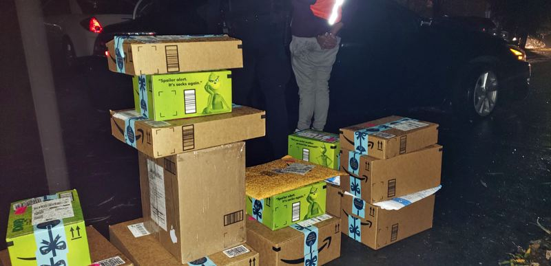 PHOTO: WCSO - Several allegedly stolen packages removed from the vehicle of Perez Johnson on Sunday.