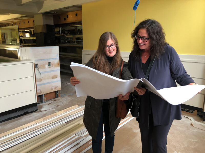 PAMPLIN MEDIA GROUP: STEPHANIE BASALYGA - Blythe Sacho, left, a designer with Scott | Edwards Architecture, and Lisa Schroeder, a chef and the founder of Mother's Bistro and Bar, discuss plans to renovate a ground-floor space in the Embassy Suites Portland hotel into the restaurants new home.