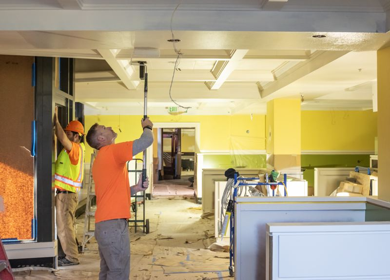 PAMPLIN MEDIA GROUP: JONATHAN HOUSE - Workers prepare the new home of Mother's Bistro and Bar. The space, on the ground-floor of the Embassy Suites Portland hotel, is on target to be be completed in time for an opening in January.