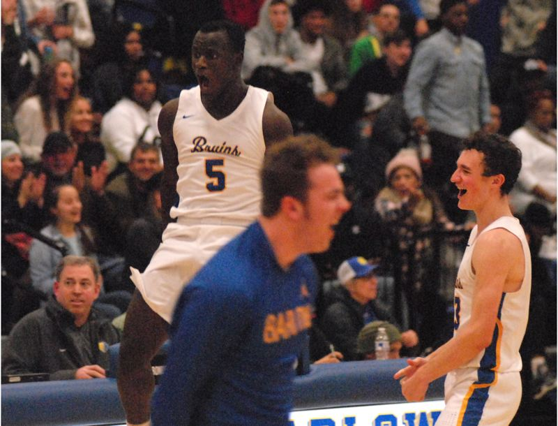 OUTLOOK PHOTO: DAVID BALL - Barlows Charles Ndayizeye, 5, lets out a shout near the scorers table after the horn sounded to end the Bruins 99-95 double-overtime win over No. 1-ranked Jefferson on Friday.