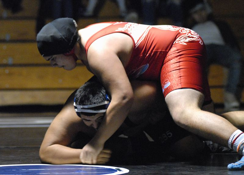 OUTLOOK PHOTO: DAVID BALL - Centennials Ihe Gonzales works to turn his opponent in the heavyweight bout, which he won on a pin with 0:16 left in the first period.