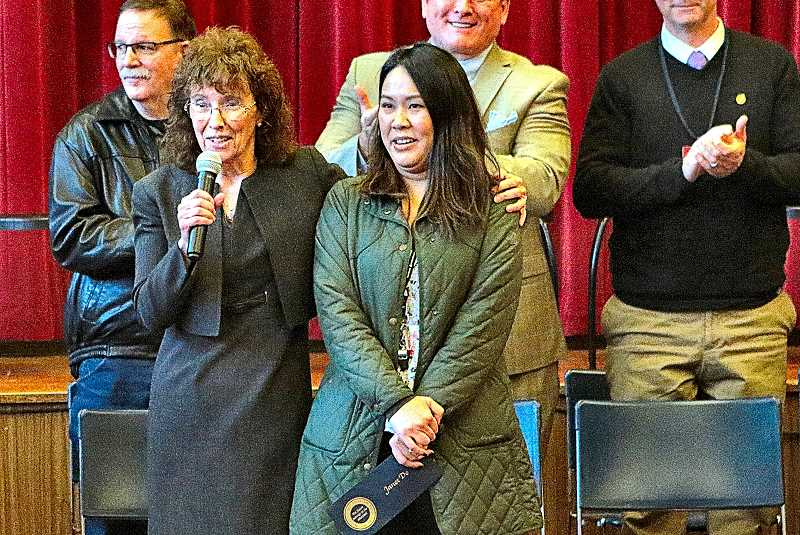 DAVID F. ASHTON - Milken Family Foundation Senior Vice President Dr. Jane Foley congratulates Whitman Elementary School first grade teacher Janet Do, on being the only Oregon teacher chosen this year for their $25,000 award for excellence in teaching.