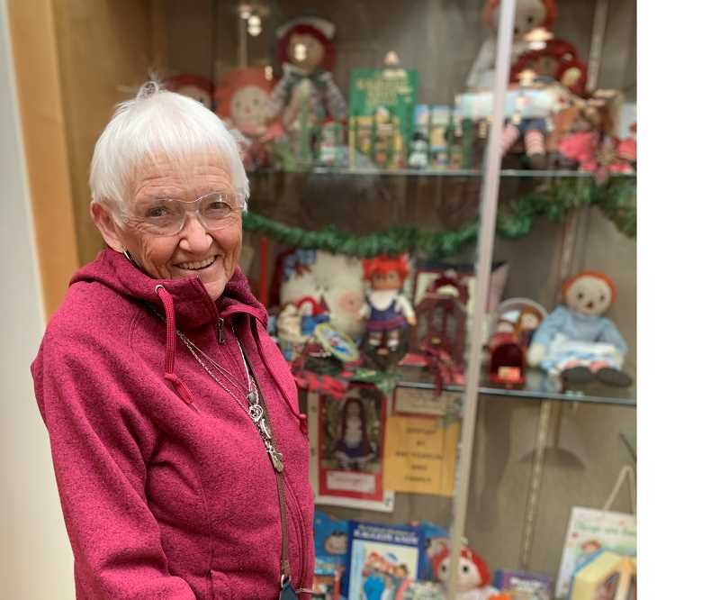 STAFF PHOTO: JANAE EASLON - Pat Yoakum, born in 1930, displays her Raggedy Ann collection at the Forest Grove Library every Christmas season.