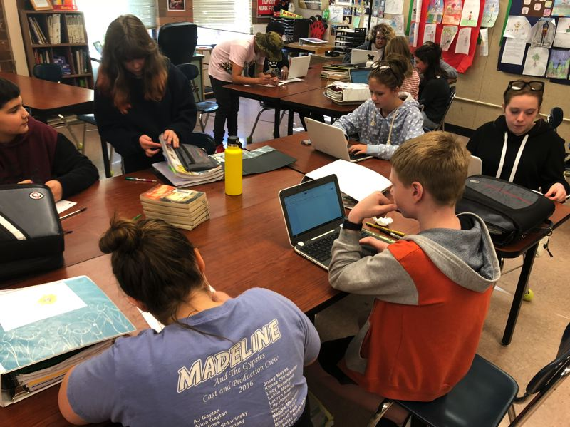 SUBMITTED PHOTO - Journalism students at Ogden Middle School use computers to research and write their online paper, which covers local and national news.