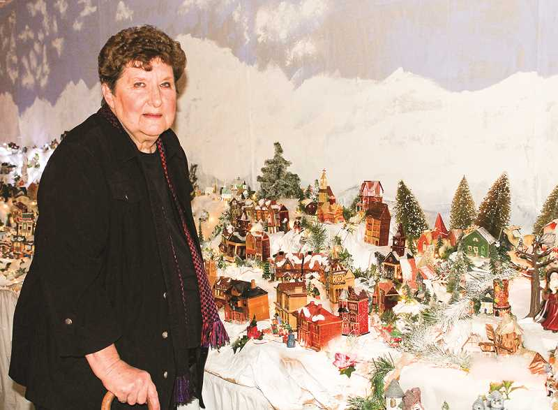 HOLLY SCHOLZ/CENTRAL OREGONIAN  - Beth Grimes stands near the original Christmas village. She and her family collect miniatures year-round to add to the display.