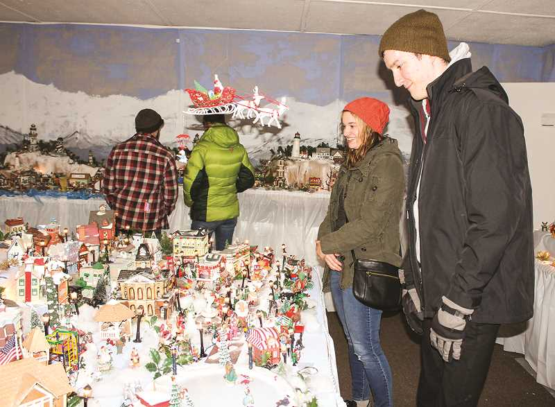 HOLLY SCHOLZ/CENTRAL OREGONIAN  - Nicole Karstetter, left, of Gresham, and Terry Rizzi, of Wisconsin, visited the scene while in Prineville celebrating Christmas early with family.