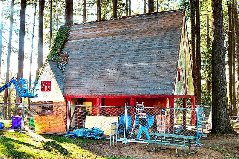 DAVID F. ASHTON - Contractors peeled off layers of moss and old wooden shingles, as repairs to the Sellwood Parks century-old kitchen building got underway.