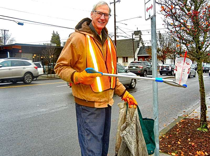 ELIZABETH USSHER GROFF - He says his name is just Barron. This Woodstock resident of picks up an unrecyclable Double Gulp, and other street trash, during his weekend neighborhood litter collections, as he has done for fifteen years.