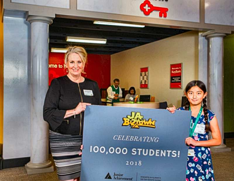 Michelle Weisenbach, president of KeyBank of Oregon and Southwest Washington, was on hand to congratulate Marysville School fifth grader Minh-Thuy, at Junior Achievements Biztown. She was the 100,000th student served by the business-education program.