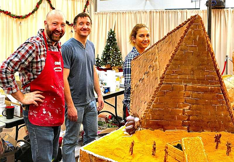 DAVID F. ASHTON - Seen admiring their pyramid trap in their entry A Game of Cat & Mouse-oleum are Russell Kofford, and Tim Allred and Rachel Ciula, representing the team of WKR Engineers, Ankrom Moisan Architects and Delice Confections.