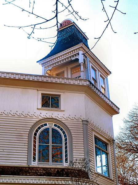 EILEEN G. FITZSIMONS - A detail of the prominent mansard-roofed tower, rising high above the three-story Russell home.