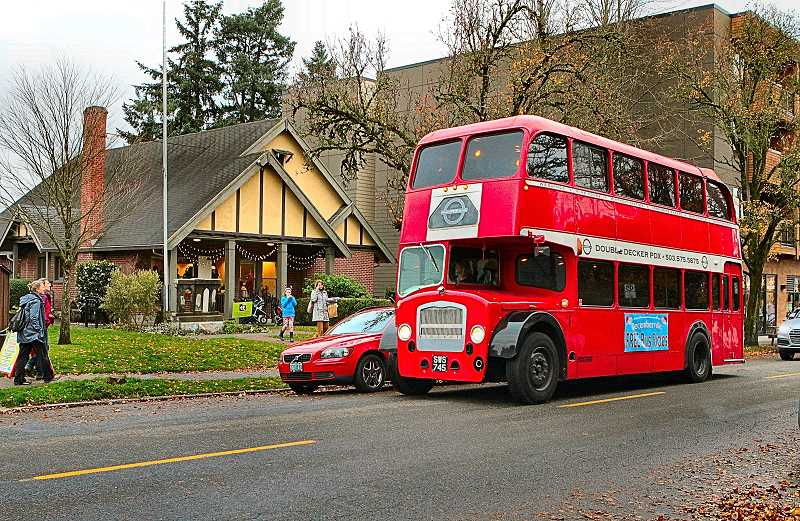 DAVID F. ASHTON - The special free double-decker bus made it easy to circle through the Westmoreland and Sellwood business districts at Decemberville.
