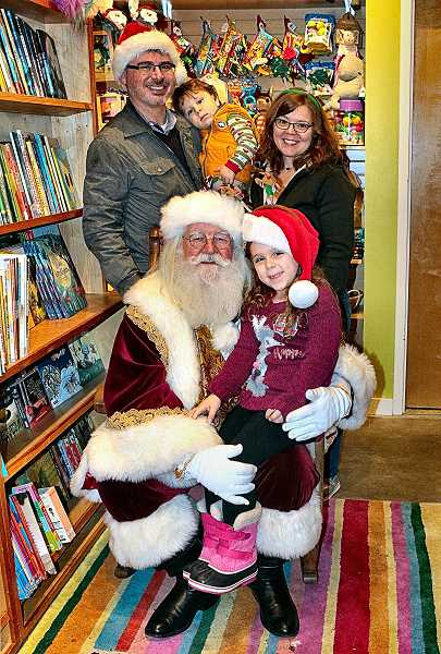 DAVID F. ASHTON - The Ryan family visiting a real live Santa Claus at Oodles 4 Kids on S.E. 13th Avenue. They were visiting Sellwood from the Mill Park neighborhood.