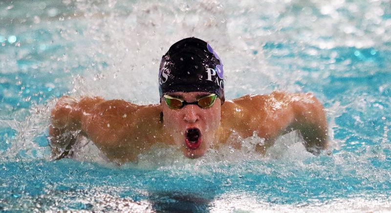 PAMPLIN MEDIA GROUP PHOTO: DAN BROOD - Lakeridge junior Jay Heymann races to victory - and a new school record - in the 100-yard butterfly against Tigard on Dec. 6 at Tigard Swim Center.