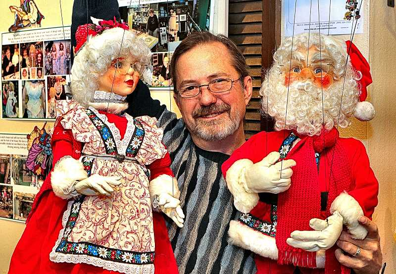 DAVID F. ASHTON - Getting ready for Holiday shows in Sellwood, heres the Portland Puppet Museums Steven Overton - with help from Mrs. Claus, and Santa.