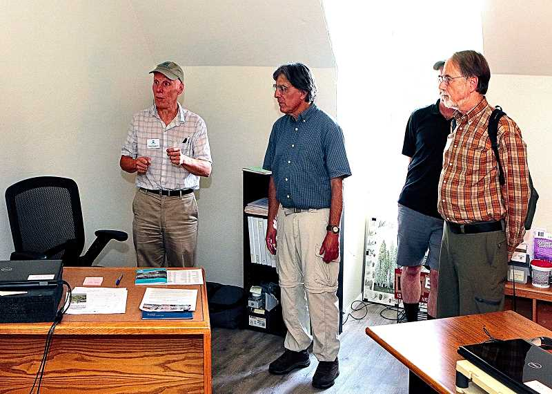 DAVID F. ASHTON - On an office-by-office tour of their new Woodstock headquarters, Johnson Creek Watershed Council Executive Director Daniel Newberry (at left) explained the purpose of each room.
