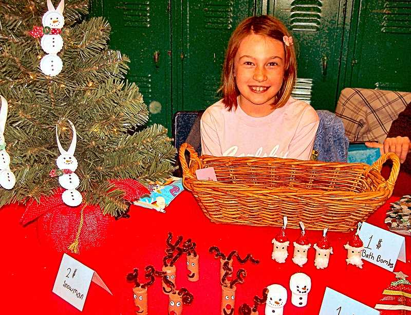 RITA A. LEONARD - Zoe, age 9, created Christmas ornaments to sell in the Llewellyn Holiday Market.