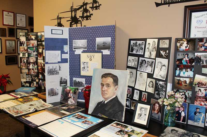 COURTESY OF PHIL MCGUIGAN - Mementos honoring John McGuigan adorned a section of the Tualatin VFW Saturday.