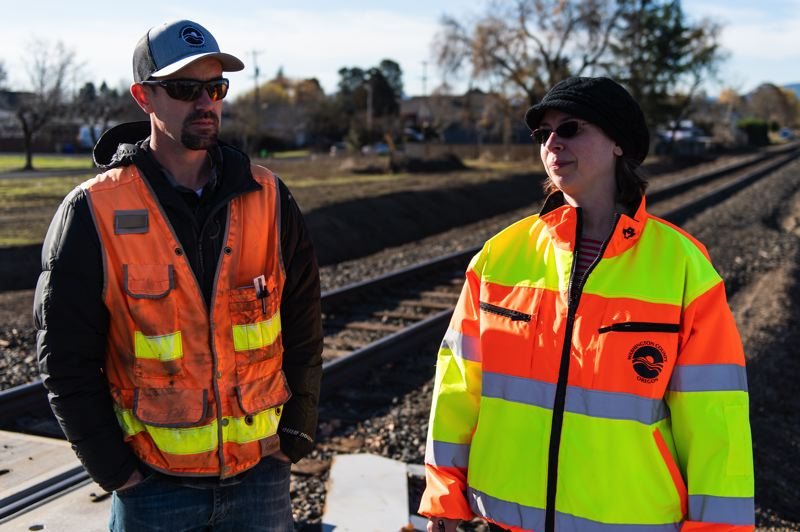 STAFF PHOTO: CHRISTOPHER OERTELL - Project manager Andy Morris and Washington County communications specialist Heather Sturgill show off some of the new features along 10th Avenue in Cornelius.