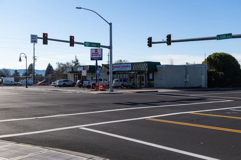 STAFF PHOTO: CHRISTOPHER OERTELL - The intersections of 10th Avenue and Adair and Baseline streets look much cleaner than they used to, with shiny new signs and signals and overhead lines moved underground.