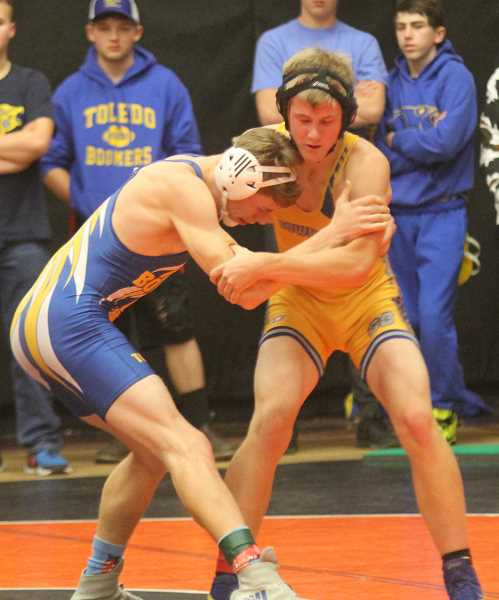 STEELE HAUGEN/MADRAS PIONEER - Elijah Becker looks to control Kyle Hayner of Toledo during their second round match at the Culver Invitational. Hayner won the match by fall, but Becker battled back through the 152-pound bracket to finish fourth in the tournament.