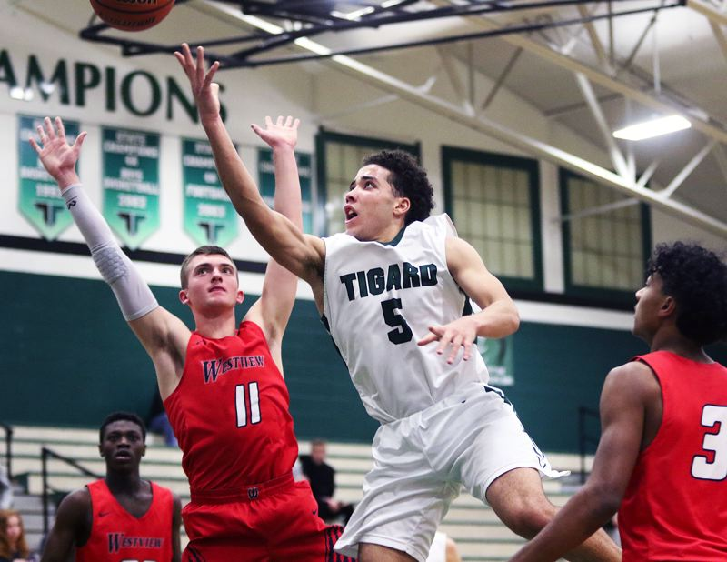 TIMES PHOTO: DAN BROOD - Tigard sophomore Drew Carter (5) goes up to the basket during the Tigers' 58-34 win over Westview on Friday.