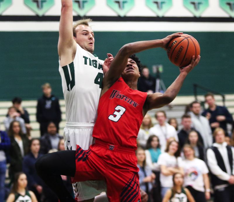 TIMES PHOTO: DAN BROOD - Westview junior London Smalley (3) looks to get to the basket against Tigard senior Stevie Schlabach during Friday's game.