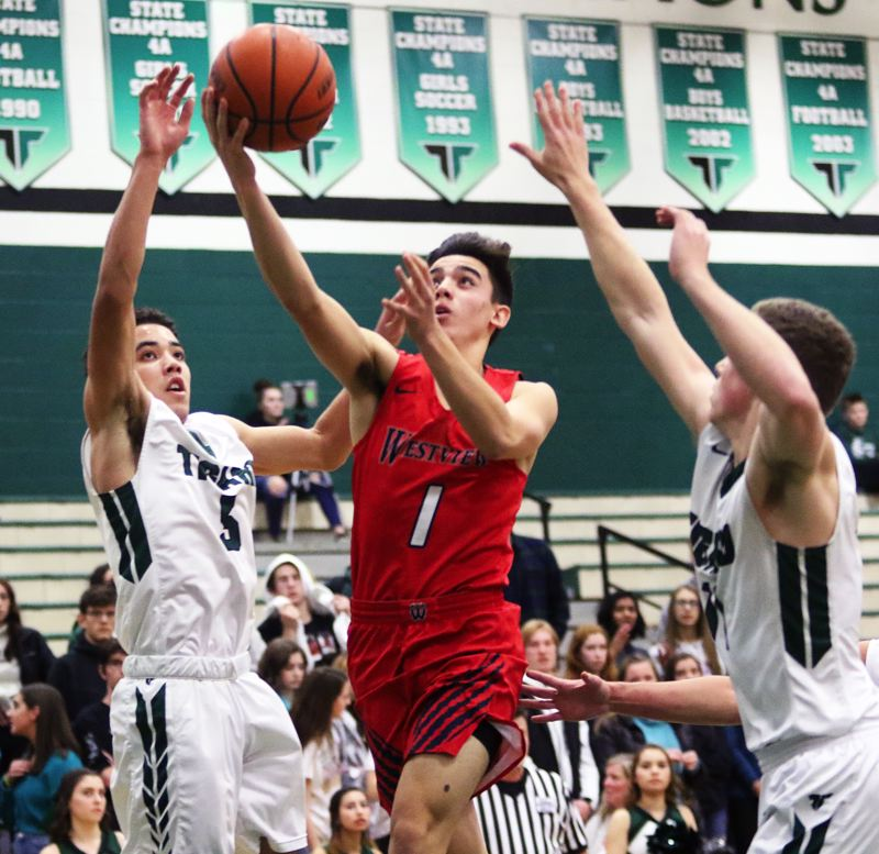TIMES PHOTO: DAN BROOD - Westview junior Cade Whitaker (1) drives to the basket during Friday's game at Tigard.