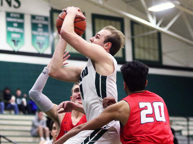 TIMES PHOTO: DAN BROOD - Tigard senior Stevie Schlabach had 20 points, 11 rebounds and a pair of steals for the Tigers in their 58-34 win over Westview.