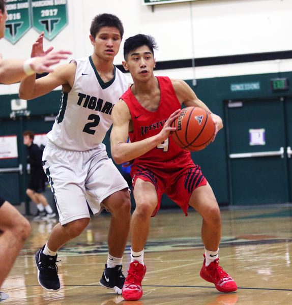 TIMES PHOTO: DAN BROOD - Tigard senior Jazz Ross (left) puts pressure on Westview's Noah Bautista during Friday's non-league game.