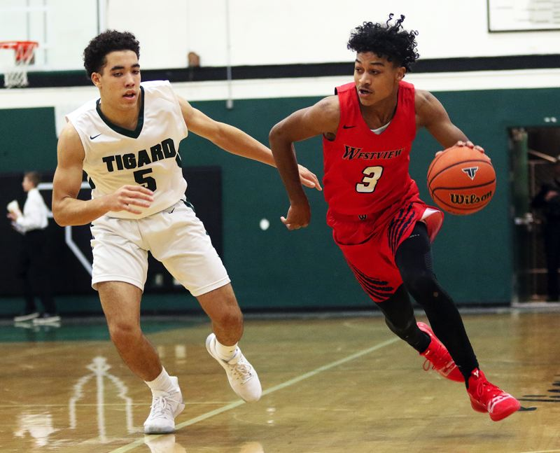 TIMES PHOTO: DAN BROOD - Westview junior London Smalley (right) looks to drive past Tigard sophomore Drew Carter during Friday's game.