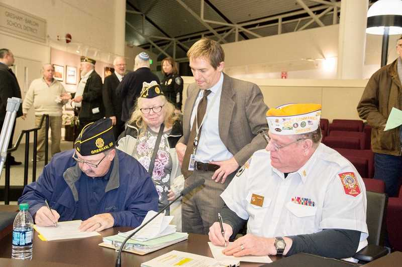 CONTRIBUTED PHOTO: AMERICAN LEGION  - American Legion Post 30 Commander George Sims, left, and Veterans of Foreign Wars Post 180 Commander David Lowe sign the extension.