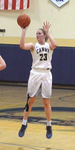 HERALD PHOTO: TANNER RUSS - Canby juniors Nicole Mickelson (featured) and Naarai Gomez were instrumental in leading Canby to its first win against Sandy. Mickelson had 19 points in the contest, and Gomez had 9 points. Sophomore Ally Odell had 13 points as well.