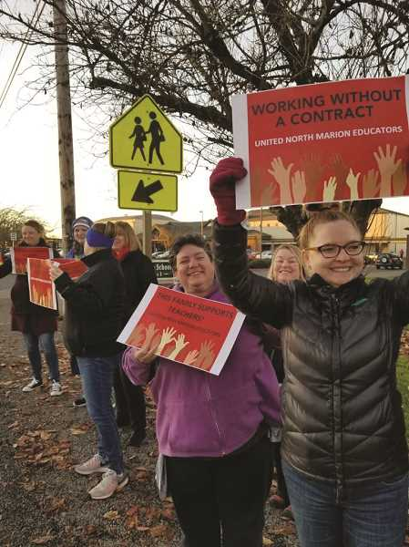 UNME - Teachers with United North Marion Educators picketed outside North Marion School District during November mediation negotiations. They plan to be out again this Monday as mediation continues.