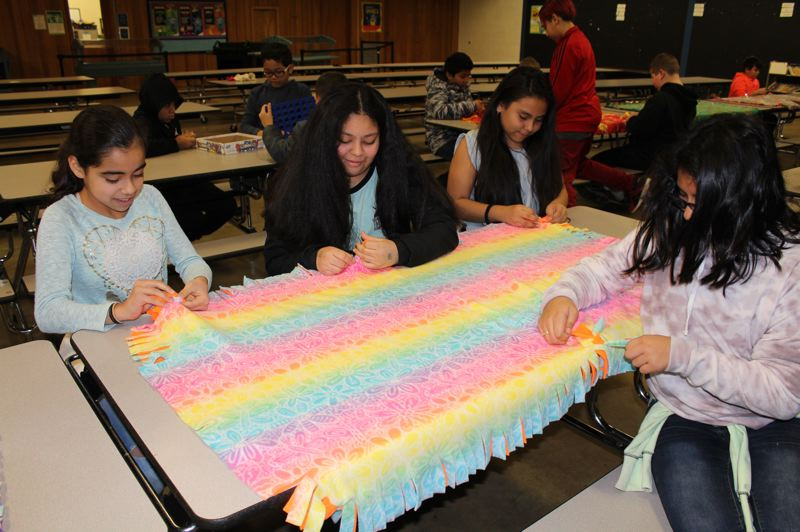 CONTRIBUTED PHOTO: GRESHAM-BARLOW SCHOOL DISTRICT - Fifth-grade students at North Gresham Elementary School work on a soft wrap for a blanket buddy.